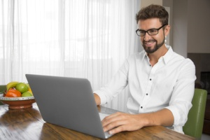 Writer working comfortably at home with his laptop