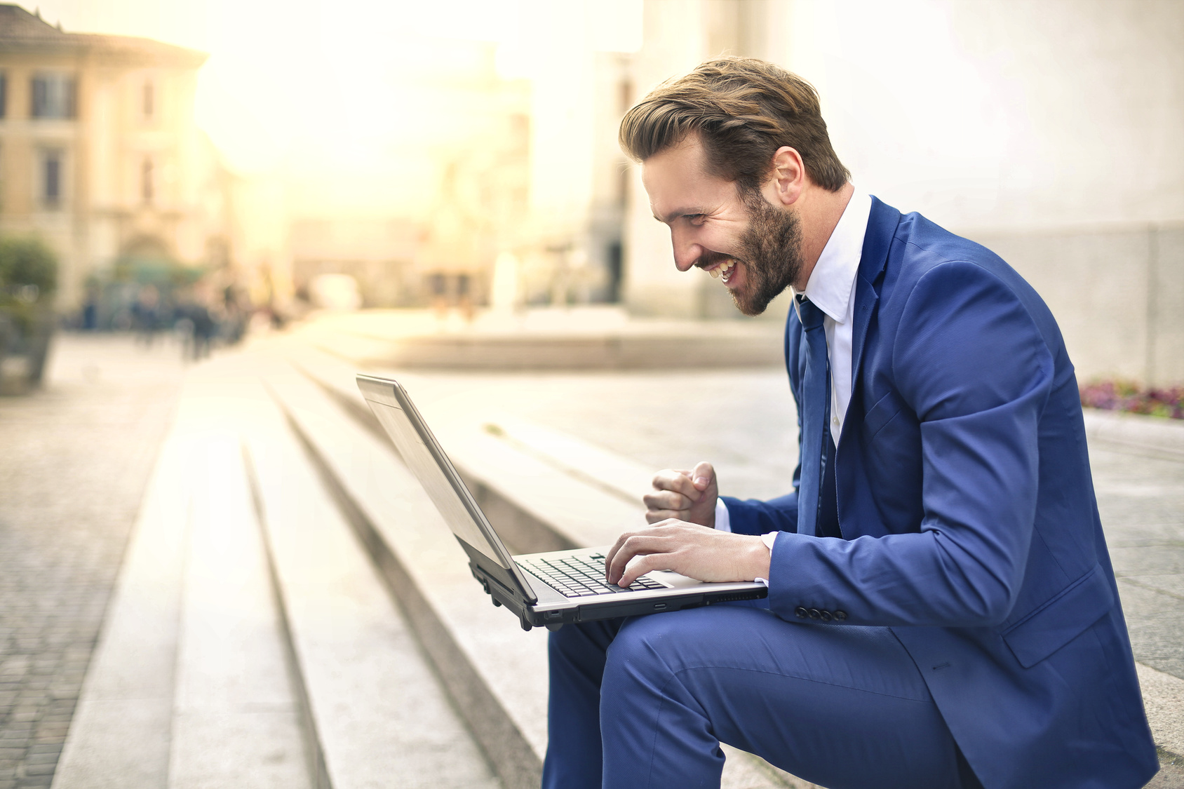 Handsome businessman using a laptop